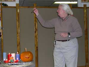 """""""Abraham reached out his hand and took the knife to kill his son."""" No, Joyce Orr is not carving the pumpkin, she's telling the story from Genesis 22 about Abraham's willingness to sacrifice Isaac as a burnt offering."""